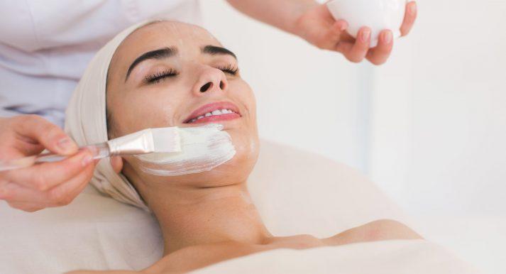 Spa facial mask application. Spa beauty organic facial mask application at day spa salon. Beauty treatment in spa salon.